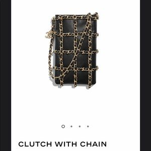 Chanel clutch with chain.